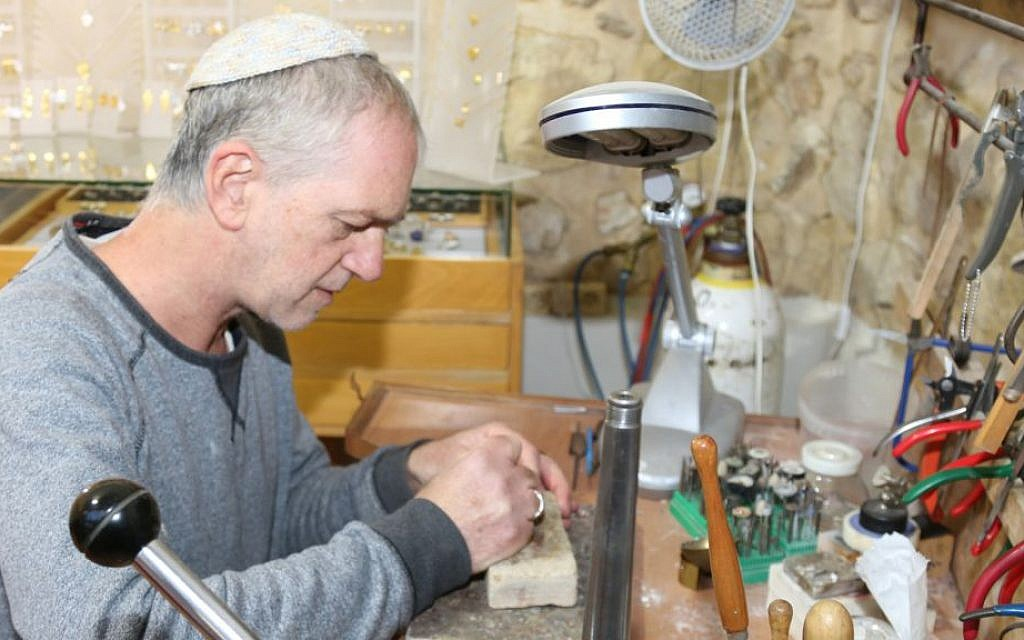 Ein Kerem artist Tzadok Yehuda creates his unique, gold and silver jewelry in Ein Kerem. (Shmuel Bar-Am)