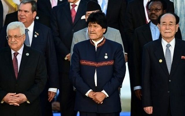 Bolivian President Evo Morales (C), North Korea's nominal head of state Kim Yong Nam (R) and Palestinian Authority President Mahmoud Abbas (L) pose during a group photo at the Non-Aligned Movement summit in Porlamar, Margarita Island, Venezuela, on September 17, 2016. (AFP PHOTO/RONALDO SCHEMIDT)