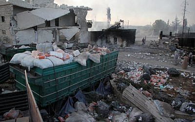 Aid is strewn across the floor in the town of Orum al-Kubra on the western outskirts of Aleppo on September 20, 2016, the morning after a convoy delivering it was hit by a deadly air strike. (AFP PHOTO/Omar Haj Kadour)