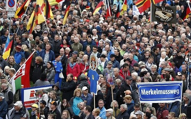 Supporters of Pegida (Patriotic Europeans Against the Islamization of the Occident) take part in a protest against German Chancellor Angela Merkel and her policy on October 3, 2016 in Dresden, eastern Germany (AFP PHOTO / Odd ANDERSEN)