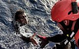 A migrant is rescued from the mediteranean sea by a member of Proactiva Open Arms NGO some 20 nautical miles north of Libya on October 3, 2016.  (Aris Messinis/AFP)