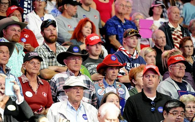 Supporters of Republican presidential nominee Donald Trump listen during his campaign stop at the Budweiser Events Center in Loveland, Colorado on October 3, 2016. (AFP PHOTO / Jason Connolly)
