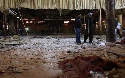Syrian men inspect the damage at a wedding hall on October 4, 2016, a day after a suicide attack targeted a Kurdish wedding party in the village of Tall Tawil in the Hasakeh province, killing 33 people. (AFP PHOTO/DELIL SOULEIMAN)