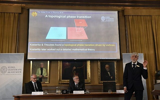 Thors Hans Hansson (R) of the Nobel Committee for Physics, speaks at a press conference to announce the winners of the 2016 physics prize at the Royal Swedish Academy of Sciences in Stockholm on October 4, 2016. (AFP PHOTO/JONATHAN NACKSTRAND)