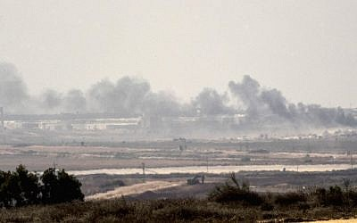 A picture taken from the Israel-Gaza border shows smoke rising from the Hamas-ruled Gaza Strip following an Israeli military strike on October 5, 2016. (Jack Guez/AFP)