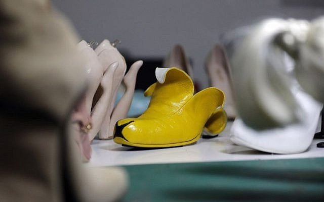 """A picture shows a shoe creation called """"Banana"""" by Israeli shoe designer Kobi Levi at his workshop in Tel Aviv, on October 5, 2016. (AFP PHOTO / THOMAS COEX)"""