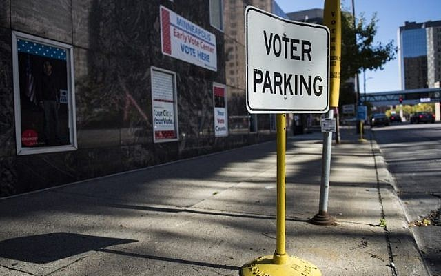 Signage outside the Early Vote Center in downtown Minneapolis, Minnesota on October 5, 2016.  (AFP/Stephen Maturen)
