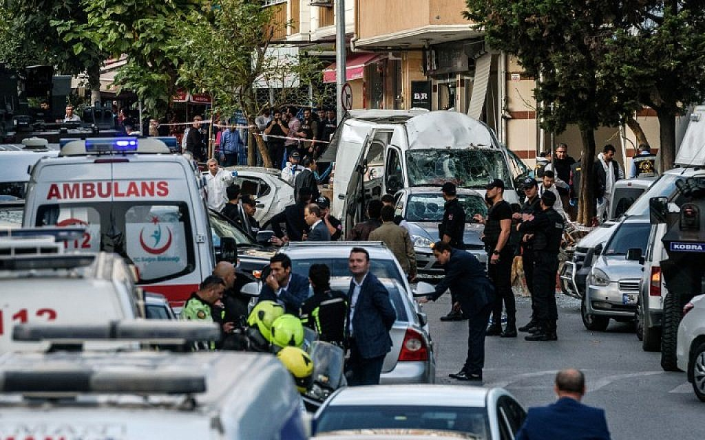 FILE: Turkish police patrol as forensic officers work at the scene of a motorbike bomb explosion, next to a police station in Istanbul on October 6, 2016. (Ozan Kose/AFP)