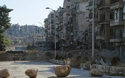 A picture shows destruction as Syrian pro-government forces advance in Aleppo's Bustan al-Basha neighborhood on October 6, 2016. (AFP PHOTO)