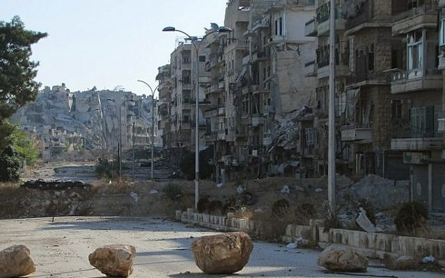 A picture shows desruction as Syrian pro-government forces advance in Aleppo's Bustan al-Basha neighbourhood on October 6, 2016. (AFP PHOTO)