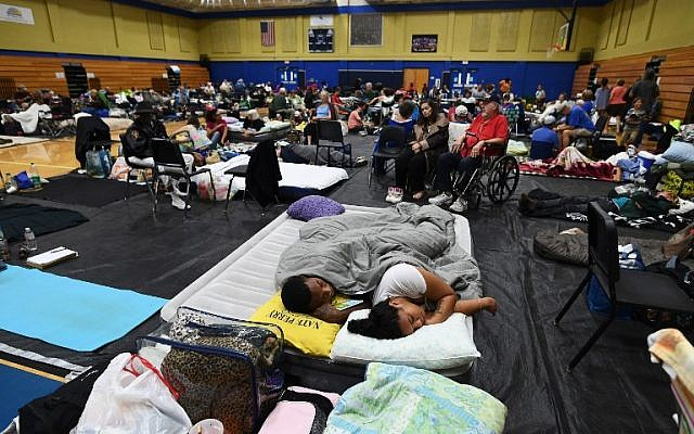 Ahead of the arrival of Hurricane Matthew, local residents take shelter at the Pedro Menendez High School in St. Augustine, Florida, October 6, 2016. (AFP/Jewel SAMAD)