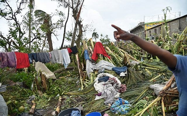 The backyard of a house where the habitants dry their clothes seen after it was destroyed by after Hurricane Matthew, Croix March-a-Terre, in Les Cayes, in the Southwest of Haiti, October 6, 2016. (AFP/HECTOR RETAMAL)