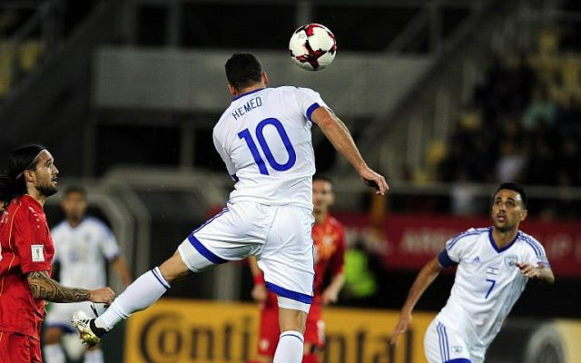 Israel's Tomer Hemed scores with a header during the World Cup 2018 football qualification match between Macedonia and Israel in Skopje on October 6, 2016. (AFP/Robert Atanasovski)