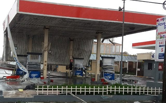 A damaged gas station is seen in Nassau, New Providence island in the Bahamas, on October 6, 2016, after the passing of Hurricane Matthew. (AFP PHOTO / Sloan SMITH)
