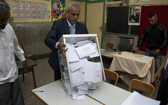 Moroccan election officials empty a ballot box during the country's parliamentary election in the capital Rabat on October 7, 2016. (AFP/Fadel Senna)