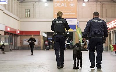 Illustrative: Police officers patrol at a train station in Chemnitz, eastern Germany, on October 8, 2016. (AFP Photo/Jens-Ulrich Koch)