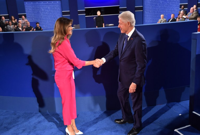 Former President Bill Clinton, right, greets Melania Trump, wife of Republican presidential candidate Donald Trump, before the start of the second presidential debate at Washington University in St. Louis, Missouri, October 9, 2016. (AFP/Paul J. Richards)