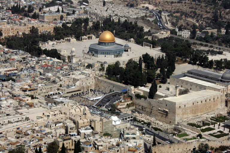 an aerial view of the dome of the rock left in the compound known