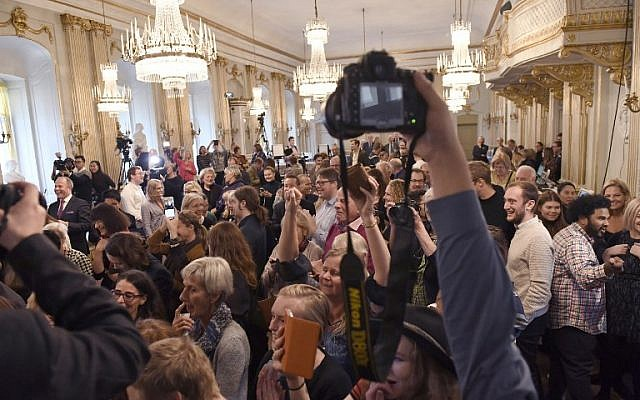 The audience reacts as Permanent Secretary of the Swedish Academy Sara Danius announces that Bob Dylan is awarded the 2016 Nobel Prize in Literature during a presser at the Old Stockholm Stock Exchange Building in Stockholm, October 13, 2016. (AFP/TT News Agency/Jonas Ekstromer)