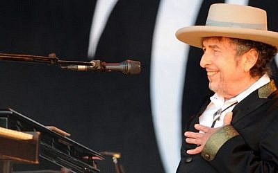 US poet and folk singer Bob Dylan performing during the 21st edition of the Vieilles Charrues music festivalin Carhaix-Plouguer, western France,  July 22, 2012. (AFP/Fred Tanneau)
