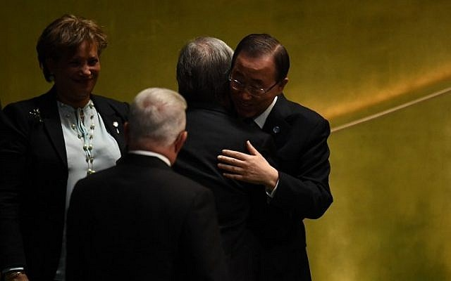 Outgoing UN Secretary General Ban Ki-moon hugs Secretary-General-designate Antonio Guterres during the ceremony for the appointment of the Secretary-General during the 70th session of the General Assembly October 13, 2016 at the United Nations in New York. (AFP PHOTO / Jewel SAMAD)