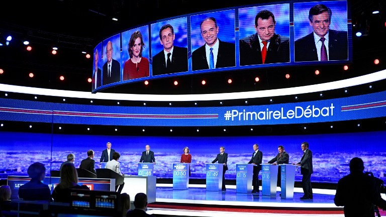 Hopefuls take part in the first televised debate between the seven candidates for France's right-wing presidential nomination ahead of the 2017 presidential election, on October 13, 2016 at the studios of French private television channel TF1, north of Paris. (AFP PHOTO / POOL / Martin BUREAU)