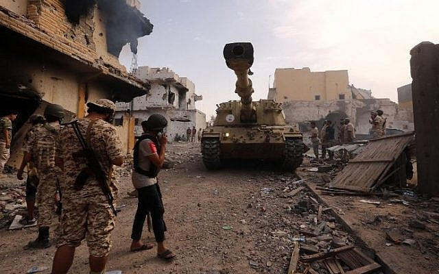 Forces loyal to Libya's UN-backed Government of National Accord (GNA) gather in the coastal city of Sirte, east of the capital Tripoli, during their military operation to clear IS jihadists from the city, on October 14, 2016. (AFP/Mahmud Turkia)