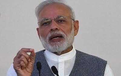 Indian Prime Minister Narendra Modi speaks at the Taj Exotica hotel in Goa on October 15, 2016. (AFP PHOTO / PRAKASH SINGH)