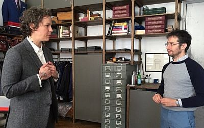 Daniel Friedman, founder of the tailoring shop Bindle & Keep, during a fitting with Ashley Merriman, a client of the shop who came to try on a new custom-made androgynous suit, October 14, 2016. (AFP Photo/Catherine Triomphe)