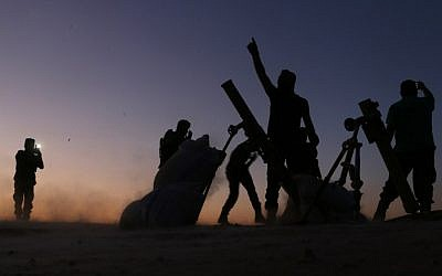 Fighters from the Free Syrian Army cheer and react as they fight against the Islamic State (IS) group jihadists on the outskirts of the northern Syrian town of Dabiq, on October 15, 2016.(AFP PHOTO / Nazeer al-Khatib)