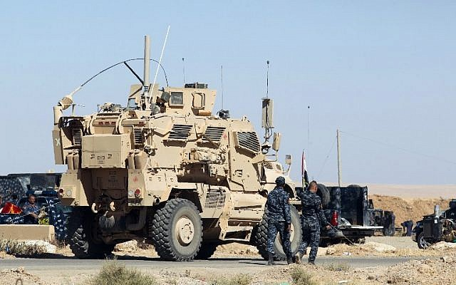 A US-made armored combat vehicle is seen parked at the Qayyarah military base, about 60 kilometers (35 miles) south of Mosul, on October 16, 2016, ahead of an offensive to retake the last IS-held city in Iraq. (AFP PHOTO/AHMAD AL-RUBAYE)