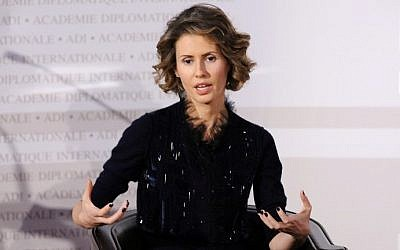 Asma al-Assad, the wife of the Syrian president gesturing as she speaks during a meeting at the International Diplomatic Academy in Paris, December 10, 2010. (AFP/MIGUEL MEDINA)