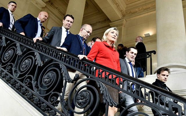 French far-right leader Marine Le Pen, center, at the Salon Planete PME, a forum for French small and medium businesses, on October 18, 2016, in Paris. (Alain Jocard/AFP)