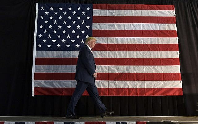 Republican presidential nominee Donald Trump arrives to speak at a rally at the Norris-Penrose Event Center in Colorado Springs, Colorado October 18, 2016. (AFP/MANDEL NGAN)