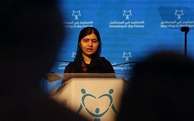 "Pakistani activist for female education and Nobel Peace Prize laureate, Malala Yousafzai, delivers a speech during a conference entitled ""Investing in The Future: Building the resilience of women and girls in the Arab region"" on October 19, 2016, in the United Arab Emirate of Sharjah. (AFP PHOTO / KARIM SAHIB)"
