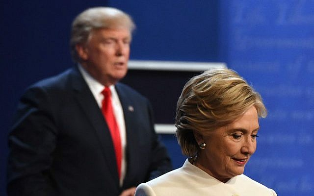 Democratic nominee Hillary Clinton, right, and Republican nominee Donald Trump walk off the stage after the final presidential debate at the Thomas & Mack Center on the campus of the University of Las Vegas in Las Vegas, Nevada on October 19, 2016. (Robyn Beck/AFP)
