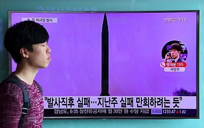 File: A man walks past a television screen showing file footage of a North Korean missile launch at a railway station in Seoul, South Korea, on October 20, 2016. (AFP Photo/Jung Yeon-Je)