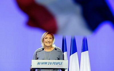 This file photo taken on September 18, 2016 shows Front National (FN) party leader Marine Le Pen delivering a speech behind a French national flag during the FN's summer congress in Frejus, southern France. (Franck Pennant/AFP)