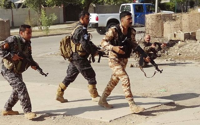 Iraqi Kurdish security forces patrol a street in the southern suburbs of Kirkuk on October 22, 2016, after jihadist gunmen attacked the city. (AFP PHOTO / Marwan IBRAHIM)