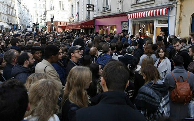 People gather for the opening of the Yummy Pop gourmet popcorn shop in the Marais district of Paris on October 22, 2016, a joint effort of US actress Scarlett Johansson and her French husband, advertising executive Romain Dauriac. (Benjamin Cremel/AFP)