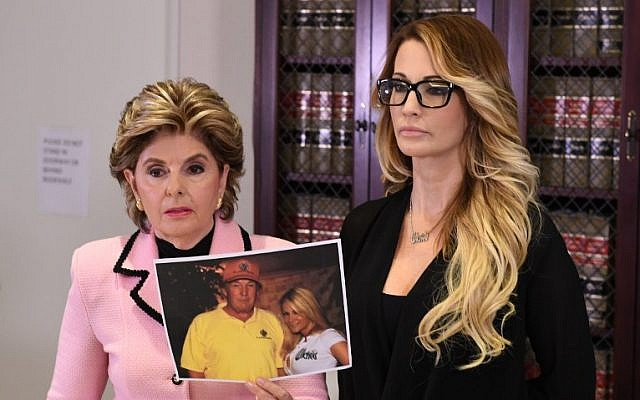 Jessica Drake (R), who works for an adult film company, speaks beside attorney Gloria Allred (L) about allegations of sexual misconduct against Republican presidential hopeful Donald Trump during a press conference in Los Angeles, California on October 22, 2016.  (AFP PHOTO / Mark RALSTON)