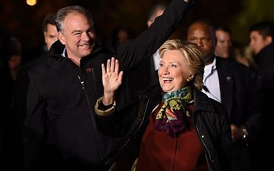 Democratic presidential nominee Hillary Clinton, right, attends a campaign event with running mate Tim Kaine, at Dunning-Cohen Champions Field, Penn Park in Philadelphia, Pennsylvania, October 22, 2016. (AFP/Robyn Beck)