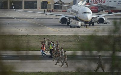 Members of Malta's Armed Forces check the runway after a small passenger aircraft crashed on takeoff at Malta's international airport on October 24, 2016, killing all five people onboard, officials said. (AFP/Matthew Mirabelli)