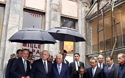 Palestinian leader Mahmoud Abbas (3L) visits a part of the Turkish parliament building that was damaged during the July 15 failed coup attempt in Ankara, on October 24, 2016.   (AFP PHOTO / ADEM ALTAN)
