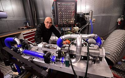 Shaul Yakobi, inventor and co-founder at Aquarius Engines, poses for a photo with the single-piston car engine he invented, at Campus Automobile Spa-Francorchamps in Belgium on October 19, 2016. (AFP/Emmanuel Dunand)