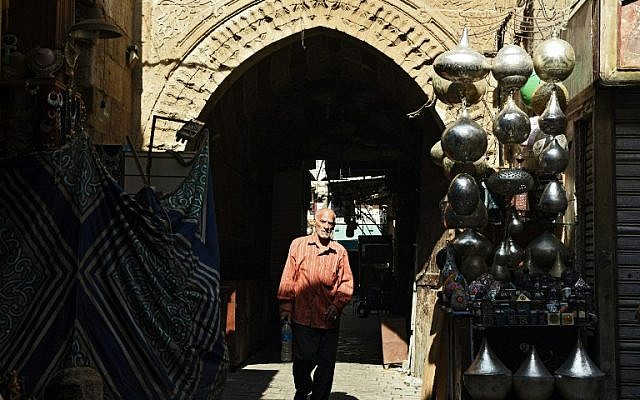 An Egyptian man walks in the tourist area of Al-Hussein in the capital Cairo, October 24, 2016. (AFP/MOHAMED EL-SHAHED)