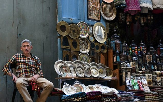 An Egyptian vendor sits outside his shop in the tourist area of Al-Hussein in the capital Cairo, October 24, 2016. (AFP/MOHAMED EL-SHAHED)