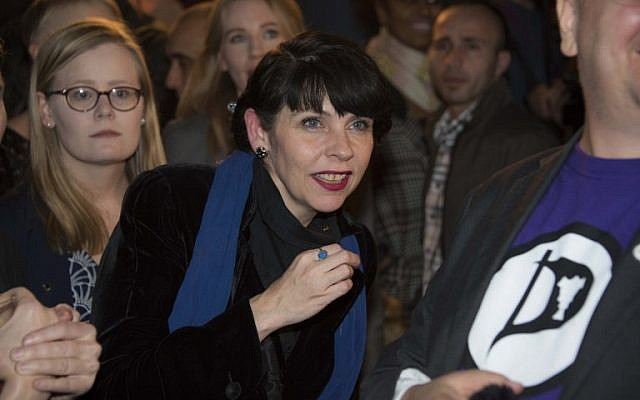 Politician and co-founder of Iceland's Pirate Party Birgitta Jonsdottir, center and fellow activists react as the election results are announced at their election gathering in Reykjavik, Iceland, October 25, 2016. (AFP/Halldor KOLBEINS)""