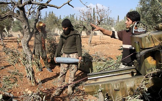 Rebel fighters from the Jaish al-Fatah Brigades prepare mortar shells before firing towards western government-controlled districts of Aleppo on October 30, 2016, the third day of a rebel offensive to break a three-month siege of the opposition-held east of Syria's second city. (AFP Photo/Omar Haj Kadour)