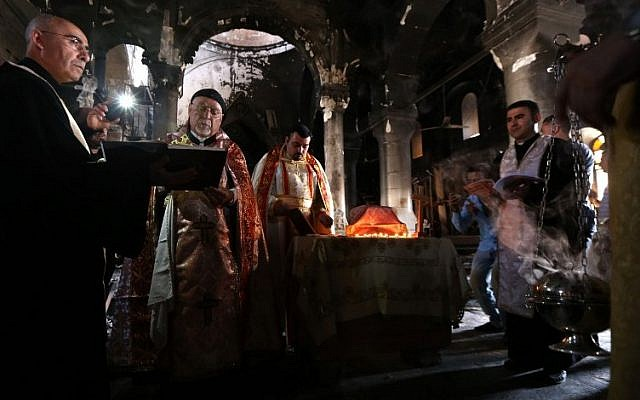 Archbishop Yohanna Petros Mouche (2-L) of Mosul leads a mass at the Church of the Immaculate Conception on October 30, 2016 in the town of Qaraqosh (also known as Hamdaniya), 30 kms east of Mosul, after Iraqi forces recaptured it from Islamic State (IS) group jihadists. (AFP/ SAFIN HAMED)
